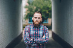 Handsome man with beard stands on the street Stock Images