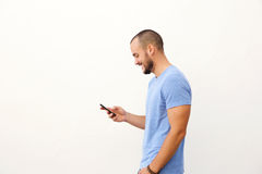 Handsome man with beard walking with mobile phone. Against white background Stock Image