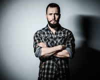 Handsome man with beard. Wearing checkered shirt Royalty Free Stock Photo