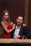 Handsome man and beautiful woman in casino Royalty Free Stock Photography