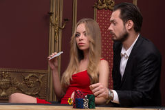 Handsome man and beautiful woman in casino Royalty Free Stock Photo