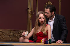 Handsome man and beautiful woman in casino Stock Photography