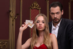 Handsome man and beautiful woman in casino Royalty Free Stock Images