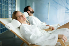 Handsome man and beautiful woman relaxing in spa Stock Images