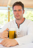 Handsome man with beer. Stock Photos