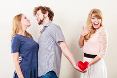 Handsome man betrayed women Stock Images