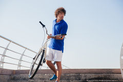Handsome man with bicycle outdoors Stock Photography