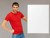 Handsome man with big blank board Royalty Free Stock Photo