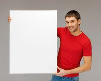 Handsome man with big blank board Royalty Free Stock Images