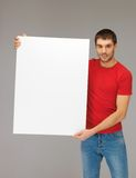 Handsome man with big blank board Stock Image