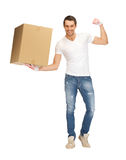 Handsome man with big box Royalty Free Stock Image