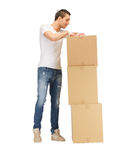 Handsome man with big boxes Royalty Free Stock Photography