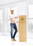 Handsome man with big boxes Stock Images