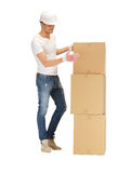 Handsome man with big boxes Royalty Free Stock Images
