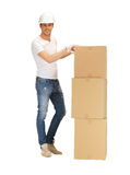 Handsome man with big boxes Stock Photography