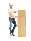 Handsome man with big boxes Stock Image