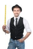 Handsome man in black hat with measure tape. Stock Images