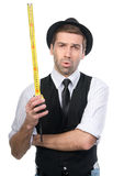 Handsome man in black hat with measure tape. Royalty Free Stock Image