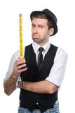 Handsome man in black hat with measure tape. Stock Photos