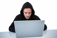 Handsome man in black hoodie using laptop Stock Photo