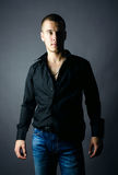 Handsome man in black shirt Stock Photography