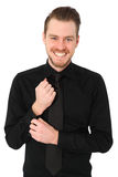 Handsome man in black shirt and tie Stock Image