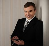 Handsome man in black suit Royalty Free Stock Images