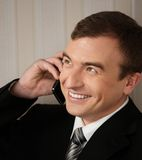 Handsome man in black suit Stock Image