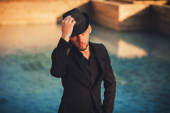 Handsome man in a black suit outdoor Stock Photography