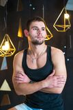 Handsome man in black tank top, posing, fashion portrait. Handsome man in black tank top, posing Stock Images
