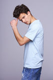 Handsome man in blank blue t-shirt Stock Image