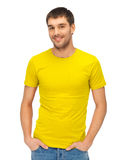 Handsome man in blank yellow shirt Royalty Free Stock Images