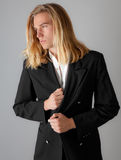 Handsome Man in Blazer. A portrait of an attractive young man in a black blazer stock photo
