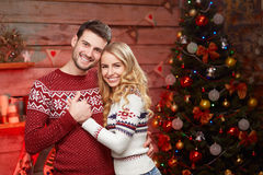 Handsome man and blond young woman celebrating winter holidays royalty free stock photo