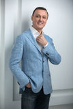 Handsome man in a blue jacket stock images