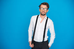Handsome man on blue wearing white shirt and braces Royalty Free Stock Photos