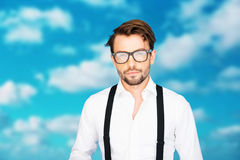 Handsome man on blue wearing white shirt and braces Royalty Free Stock Images