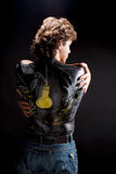 Handsome man with bodyart. Handsome man with body art on his back isolated on black Royalty Free Stock Photography
