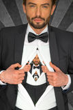 Handsome man in a bow tie baring his chest stock images