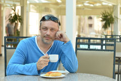 Handsome man at breakfast Stock Images