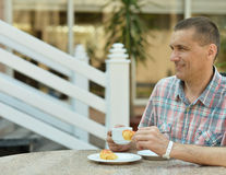 Handsome man at breakfast Stock Photos