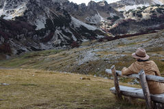 Handsome man in brown hat and coat enjoying autumn mountains Dur Stock Photography