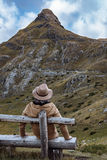 Handsome man in brown hat and coat enjoying autumn mountains Dur Stock Images