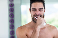 Handsome man brushing his teeth Stock Photography