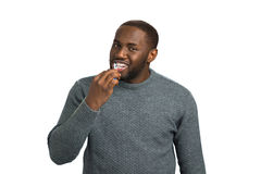 Handsome man brushing his teeth. Afro american man excited about brushing his teeth. Oral health care Stock Photos