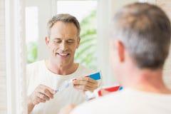 Handsome man brushing his teeth Stock Photo