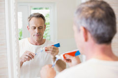 Handsome man brushing his teeth Stock Images