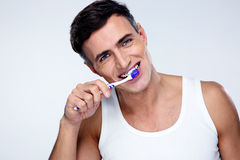 Handsome man brushing his teeth Royalty Free Stock Images