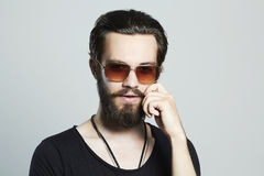 Handsome man. Brutal bearded Sexy boy in trendy sunglasses Stock Photography
