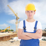 Handsome man in builder uniform at construction site Stock Images